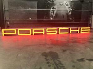 2003 Porsche dealership very long illuminated sign