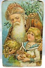 1910 POSTCARD MERRY CHRISTMAS, SANTA CLAUS WEARING BROWN,ARM AROUND BOY