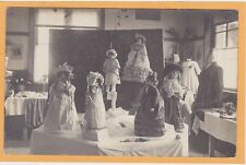 Real Photo Postcard RPPC - Display of Beautiful Dolls and Women's Clothing