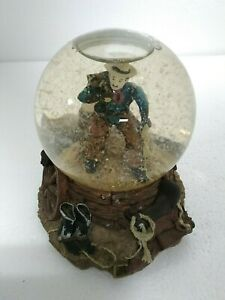 Western Cowboy w/ Saddle MUSICAL SNOW GLOBE Playing Home on the Range