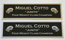 Miguel Cotto nameplate for signed boxing gloves trunks photo