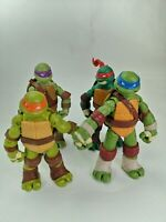 All four Teenage Mutant Ninja Turtles figures playmates 2012