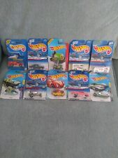 10 Different Original Never Opened Hot Wheels Die Cast cars and trucks