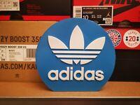 Adidas plastic logo display