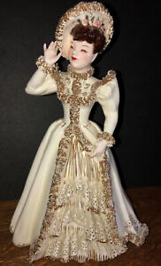 Vintage Occupied Japan Porcelain Figurine Of Victorian Woman With Red Bow Tie Holding Up Dress collectable