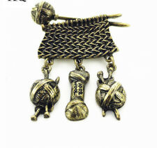 VINTAGE INSPIRED ANTIQUE GOLD PLATED KNITTING BROOCH WITH THREE HANGING CHARMS
