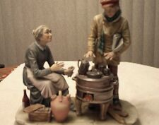 Lady sitting and a Boy warming himself Works of art from italy figurines