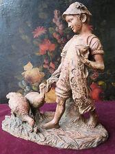 170101 Una graziosa statua in terracotta di fine Ottocento. Bambino con tacchini