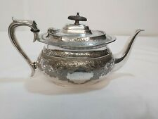 An Antique Silver Plated Tea Pot With Engraved Patterns by browetts.1800.s.
