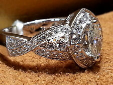18K White Gold Diamond Ring with 0.44ct. Marquise in Center and 0.92ct.VS2-G.