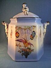 Vintage Art Deco Biscuit Barrel with applied doll like figurines .Unusual.lovely