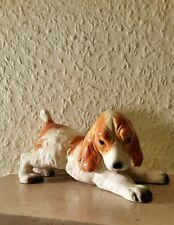 Porzellan figur/Hund.14 cm.lang u. 7 cm.hoch.