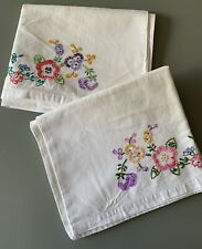 More details for pair vintage pillowcases. embroidered flowers. very pretty.