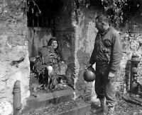 "US Soldier inspecting German dead in Cherbourg 8""x 10"" World War II Photo #162"
