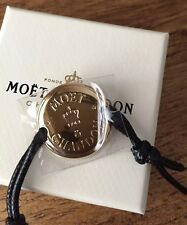 MOET CHANDON CORDED  BRACELET GOLD TONE DISC  GREAT GIFT BNIB RARE ITEM