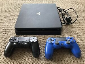 PS4 Slim 500gb Console, 2 Genuine Controllers plus 4 Games.