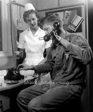 Photo.  1960s.  Soldier With Prosthetic Using Telephone