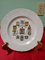 8 and Canada coat of arms and emblems Vintage souvenir plate