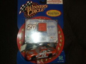 2001 tony stewart 20 home depot 1 64th scale diecast/with raced sheet metal card