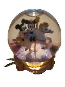 Disney musical snow globes
