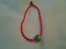 hand-made red Chinese knot bracelet with green jade looks like porcelain bead