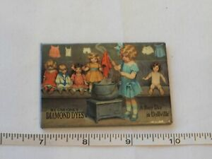 """Desperate Enterprises A Busy Day in Dollville magnet 2 1/8"""" X 3"""" Pre-owned"""