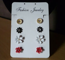 Set van 4 paar wit zwart rode gele parel oorbellen  NIEUW