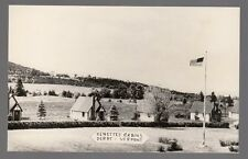 Real Photo Postcard Kenettes Cabins & American Flag Pole in Derby, Vermont