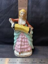 vintage porcelain figurine lady playing accordion marked Japan