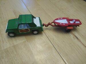 Vintage 1970 Tootsie Toy Green Jeepster with orange boat trailer Die Cast Metal