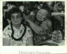 1991 Press Photo Germaine Ferguson Fixes Marge Ruzekowski's Flower, Manlius Luau