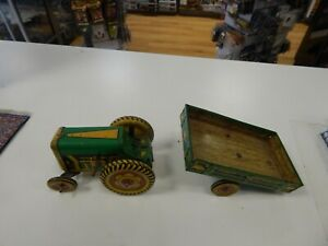 Met toy  clockwork tractor and farm trailer