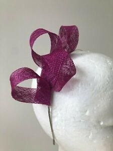 New magenta/purple loop fascinator on a silver metal headband
