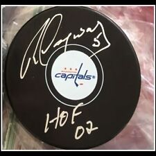 Rod Langwway autographed Capitals pucks with 2002 Hall of Fame insription