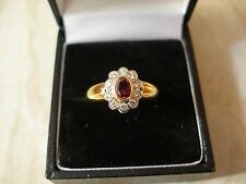 18 CARAT GOLD RUBY & DIAMOND SET CLUSTER RING MADE IN ENGLAND BRAND NEW IN BOX