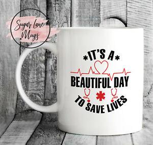 ITS A BEAUTIFUL DAY TO SAVE LIVES GREYS ANATOMY CRISTINA MEREDITH NHS CUP MUG