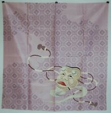 Furoshiki wrapping cloth or scarf, Okina mask on flower background, Japan