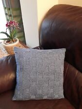 Handmade knitted cushion