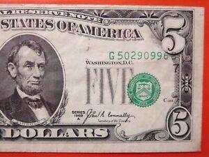 $5 1969 a federal reserve note error:  misaligned serial number  26-084