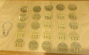 """Pack of 25 - Brady Stamped Brass CHWR Numbered Tags 1-1/2"""" Round - 151 TO 175"""