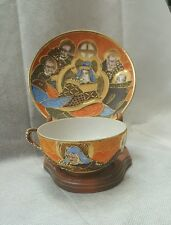 TEA CUP AND SAUCER ORANGE BLUE GOLD CLOISONNE 4 FACES OF LEADERS W STAND