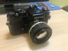 New ListingNikon Fe 35mm Slr Film Camera with Nikkor 50mm 1:1.4 Lens + Some Accessories