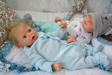 Max solid soft silicone baby doll created by artist Oxana Lukyanets