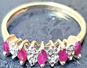 Ruby Ring, Size 6, in a 10K Gold Setting. Imprinted 10K, color is raspberry pink