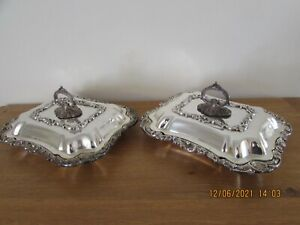 Matched pair of antique silver plated lidded entrée dishes removable handles
