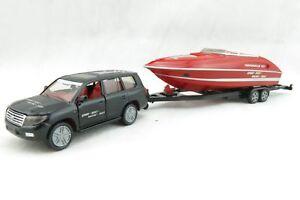 Siku 2543 - Toyota Landcruiser with performance marine Motor boat - Scale 1:55