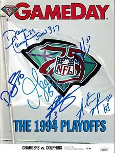 1994 Chargers team signed program Junior Seau Rodney Harrison Means Carney (JSA)