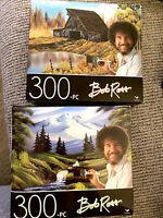 NEW Bob Ross 300 Piece Puzzle set of 2 Mountain Hide-Away and Rustic Barn
