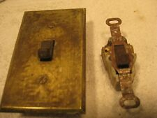 2 vintage ceramic electric toggle switches and brass cover plates