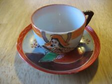 Tiny Teacup and Saucer Marked JAPAN on bottom of both.